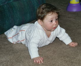 Olivia trying to crawl.