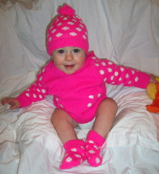 Olivia at 10 months in a hot pink Old Navy sweater and hat.