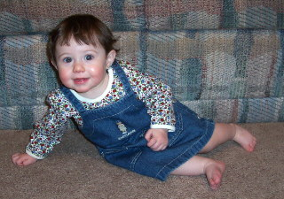 Olivia at 9 months wearing a Ralph Lauren jumper.